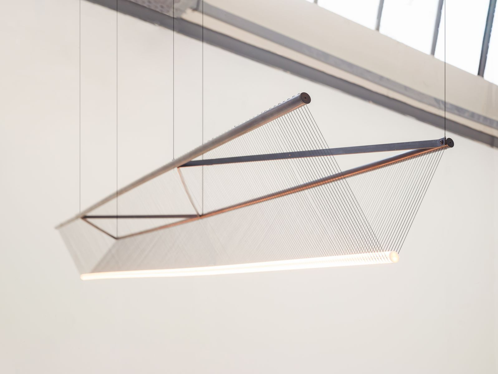 Spun Beam by Umut Yamac. Patinated brass, thread, stainless steel